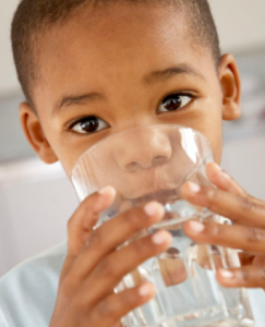 Boy Drinking Water with Fluoride