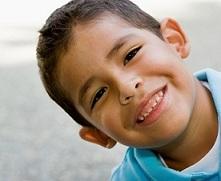 HispanicBoyTiltsHead_iStock_000006817144