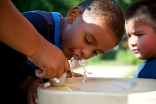 Boy Using Water Fountain